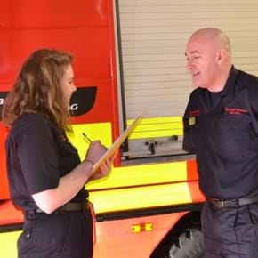 Apprentice interviewing a firefighter